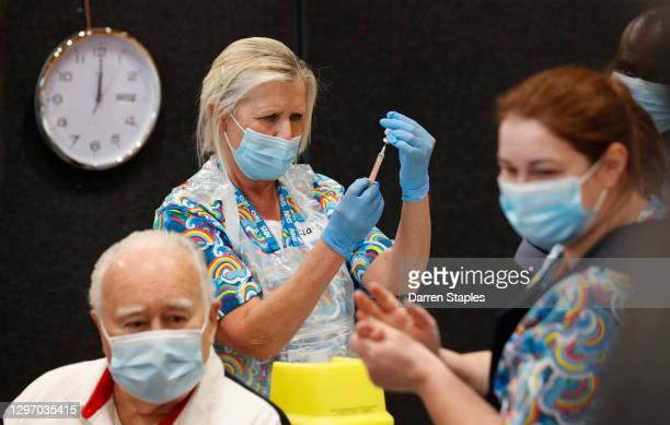 An Astrazeneca Covid-19 vaccine is prepared at the Princess Royal Sports Arena on January 18, 2021 in Boston, England. Ten new mass vaccination...