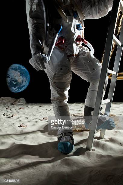 an astronaut climbing the ladder of a lunar lander on the moon - ladder to the moon stock pictures, royalty-free photos & images