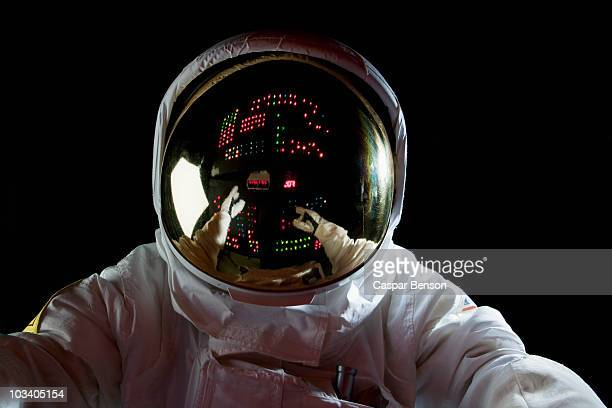 an astronaut in space making adjustments to a control panel - space exploration stock pictures, royalty-free photos & images