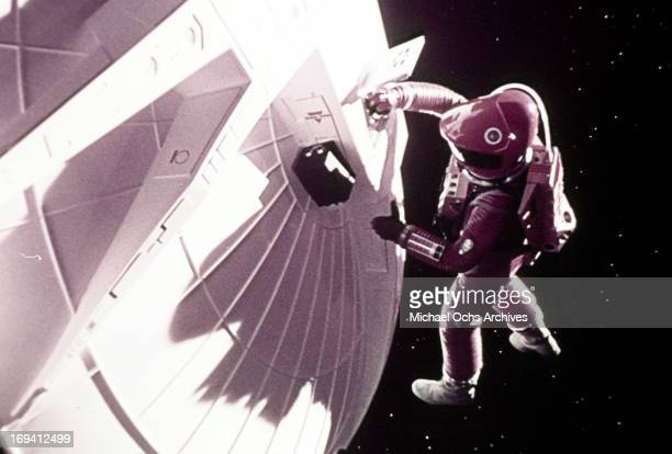 An astronaut inspects the exterior of the craft in a scene from the film '2001 A Space Odyssey' 1968