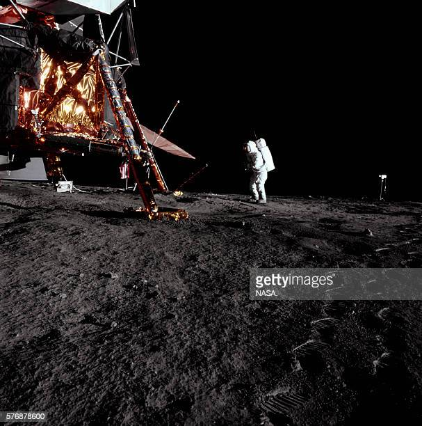 An astronaut leaves footprints on the Moon walking near the lunar module Intrepid during the Apollo 12 mission | Location Oceanus Procellarum Moon