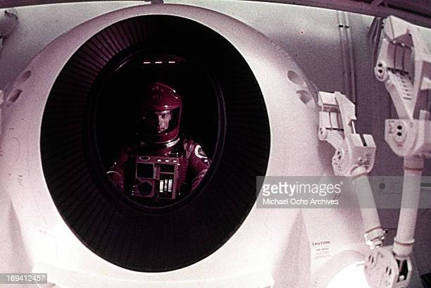 An astronaut looks out the window in a scene from the film '2001 A Space Odyssey' 1968