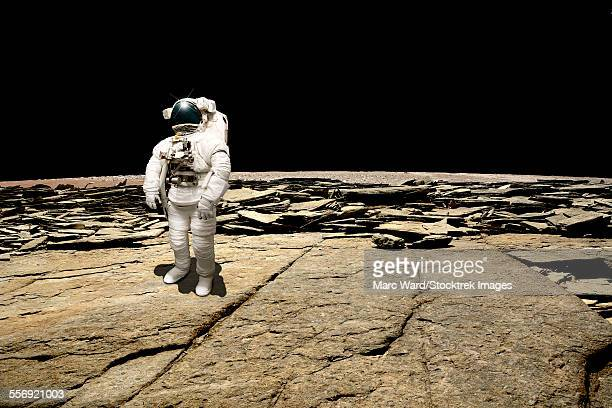 An astronaut surveys his situation after being marooned on a barren planet. The blackness of deep space is the background.