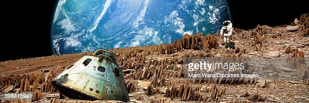 An astronaut surveys his situation on a barren and rocky moon.