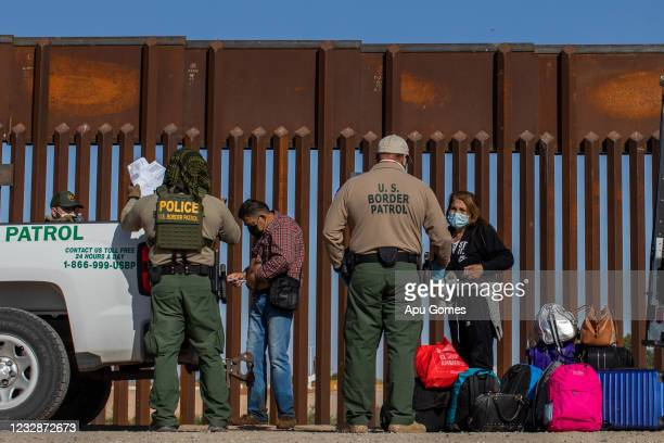 An asylum seeker from Colombia injects insulin after he turned himself in to US Border Patrol agents on May 13, 2021 in Yuma, Arizona. The Biden...