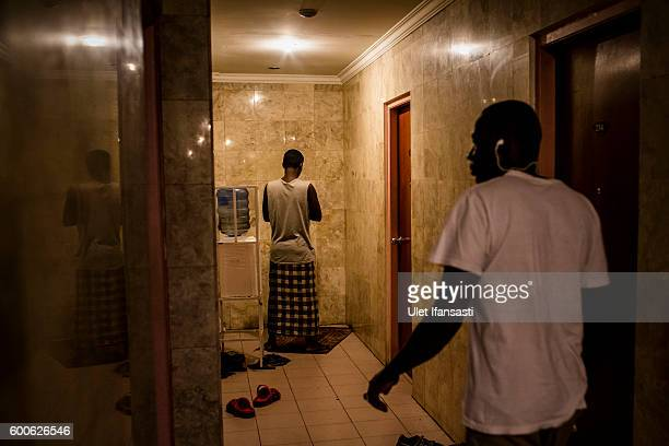 An asylum seeker from Somalia prays in the corridor of the Kolekta hotel where hundreds of refugees and asylum seekers stay for years while waiting...