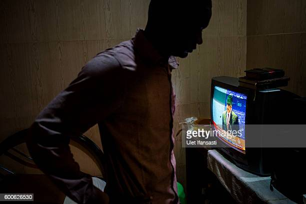 An asylum seeker from Somalia stands inside his room in the Kolekta hotel where hundreds of refugees and asylum seekers stay for years while waiting...