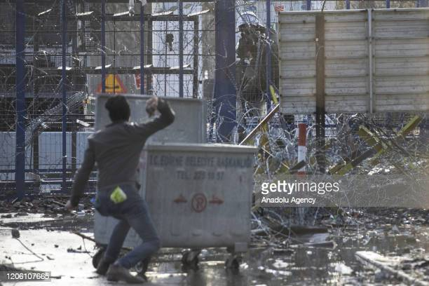 An Asylum seeker throws a stone to Greek security forces in the region between the Kastanies and the Pazarkule border gates on March 08, 2020....