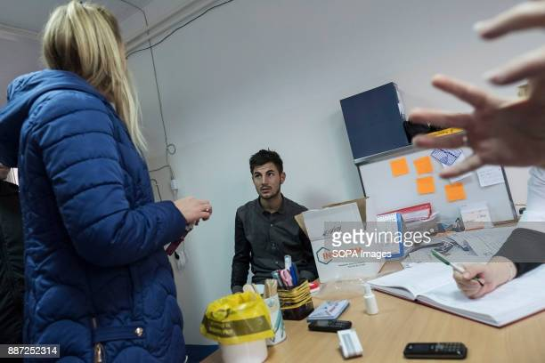 CAMP KRNJACA BELGRADE SERBIA An asylum seeker waits for his chance to pick up some medication from resident doctor in a Serbian refugee camp With...