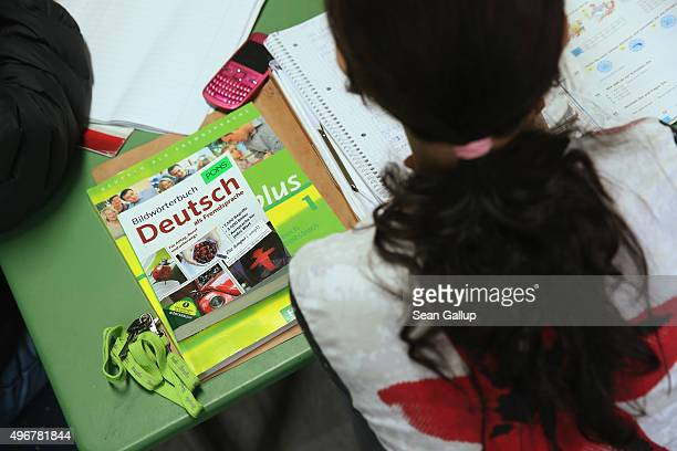An asylumapplicant from Albania sits next to her Germanlanguage textbook during a Germanlanguage class at the Gierso Boardinghaus Berlin shelter...