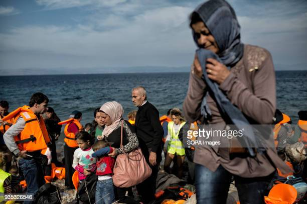 An asylumseeker arrives in Greece after crossing the Aegean from Turkey along with dozens of other boats each carrying as many as 40 people In 2015...