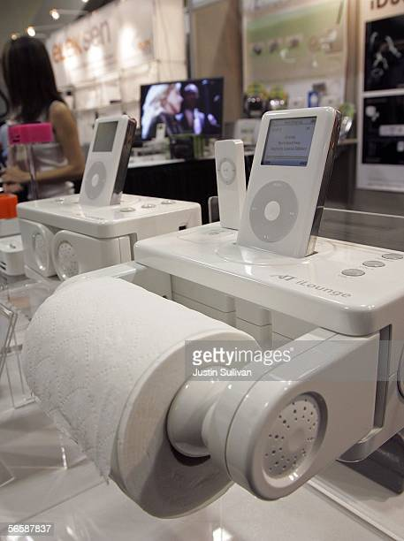 An Atech Flash Technology iPod player dock and toilet tissue dispenser is seen on display at the Macworld Conference and Expo January 13, 2006 in San...