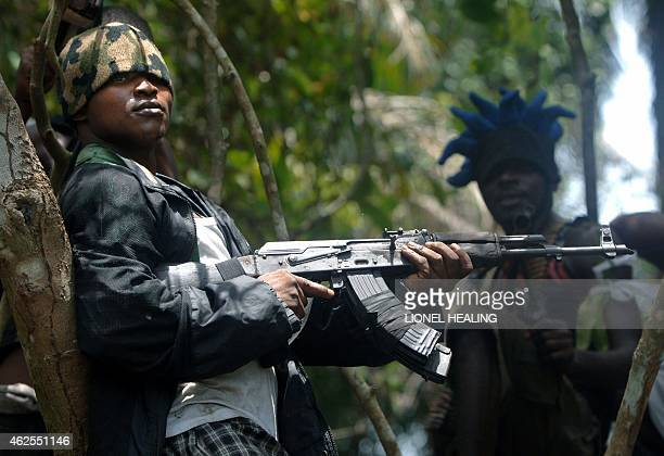 An Ateke Tom militant stands guard at his camp 13 April 2007 in Okrika Rivers State Many militant groups in the delta say they are fighting for the...