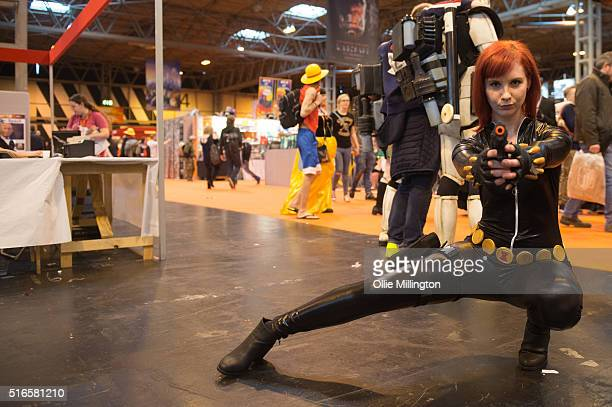 An atendee at Comic Con 2016 in cosplay as Black Widow on March 19 2016 in Birmingham United Kingdom