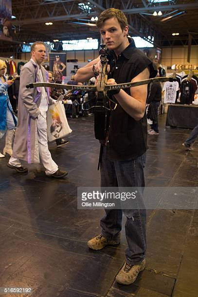 An atendee at Comic Con 2016 in cosplay as Daryl Dixon from The Walking Dead on March 19 2016 in Birmingham United Kingdom