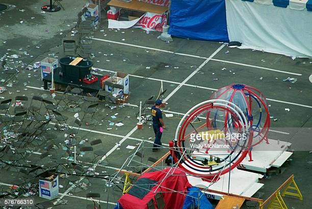 An ATF agent searches for bomb fragments and evidence in connection with a pipe bomb explosion in the Centennial Olympic Park during the 1996 Summer...
