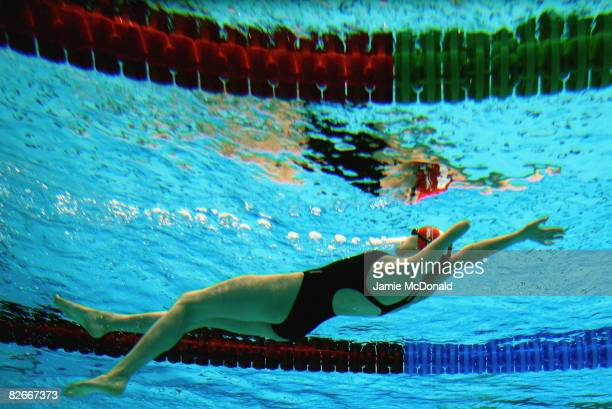 An athelete swims during a training session prior to tommorows Beijing Paralympic Games Opening ceremony at the National Aquatics Centre on September...