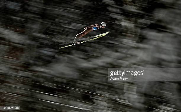 An athlet soars through the air during his qualification jump on Day 1 of the 65th Four Hills Tournament ski jumping event on January 5 2017 in...