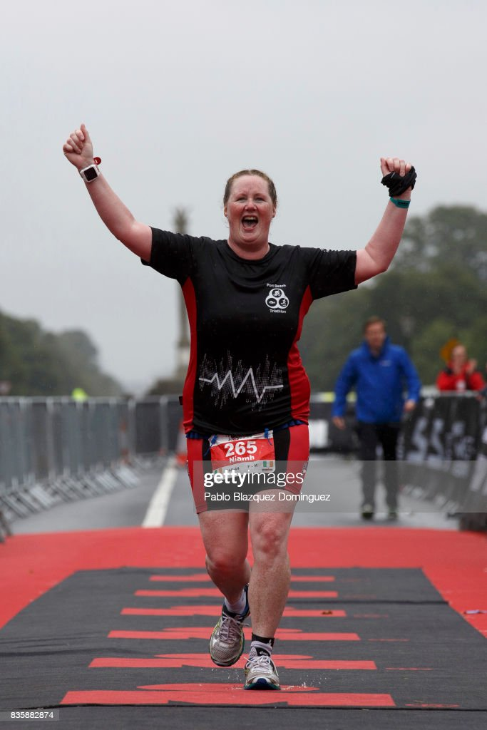 An athlete celebrates crossing the finish line during IRONMAN 70.3 Dublin on August 20, 2017 in Dublin, Ireland.