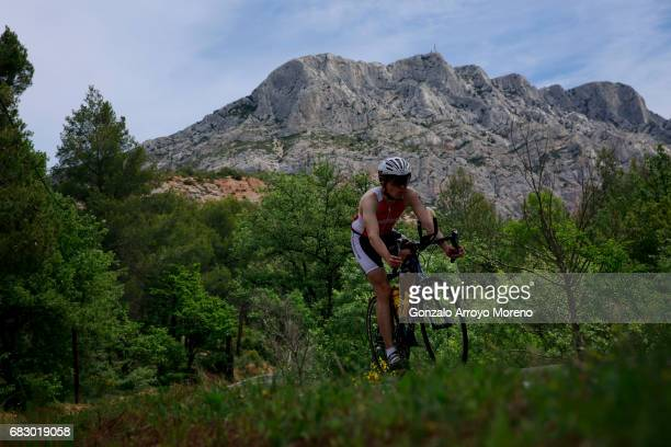 An athlete competes during the biking course of the Ironman 703 Pays d'Aix ahead Montagne SainteVictoire on May 14 2017 in France