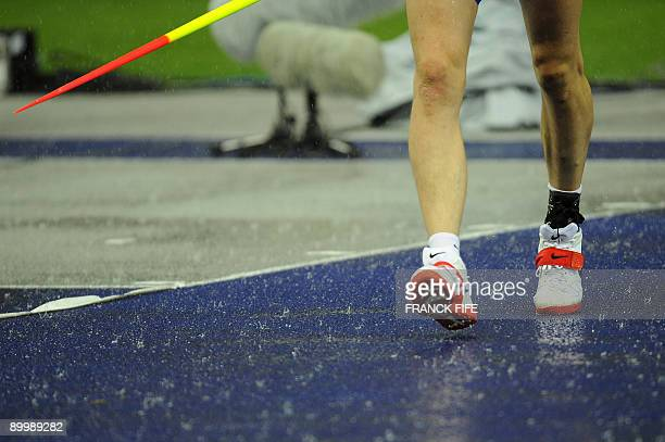 An athlete competes during the men's javelin throw qualifying event as rain pours down of the 2009 IAAF Athletics World Championships on August 21...