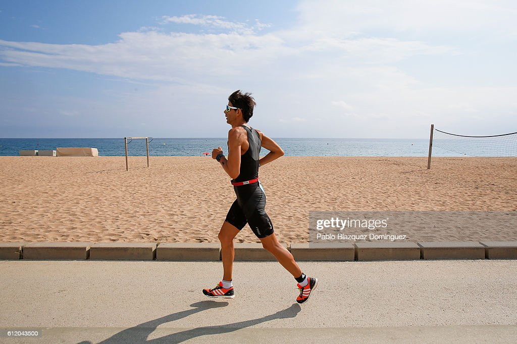 An athlete competes during the run leg of Ironman Barcelona on October 2, 2016 in Calella, in Barcelona province, Spain.