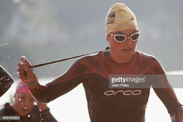 An athlete competes during the swimming leg of the Ironman 703 European Championship on August 10 2014 in Wiesbaden Germany