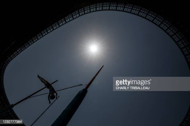 An athlete competes in a pole vault test event for the 2020 Tokyo Olympics, in the National Stadium, in Tokyo on May 9, 2021.