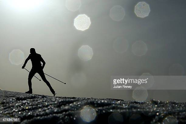 An athlete competes in the Men's 50 km Mass Start Free during day 16 of the Sochi 2014 Winter Olympics at Laura Crosscountry Ski Biathlon Center on...