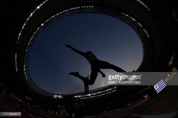 An athlete competes in the Men's Long Jump heats at the 2019 IAAF World Athletics Championships at the Khalifa International stadium in Doha on...
