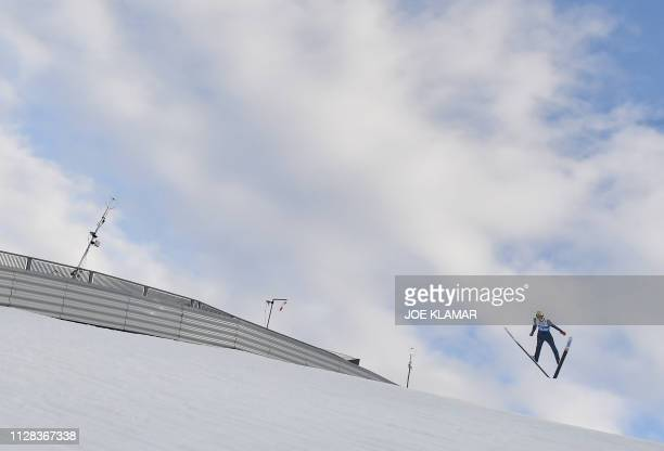 An athlete competes in the mixed team HS109 ski jumping event at the FIS Nordic World Ski Championships on March 2, 2019 in Seefeld, Austria.