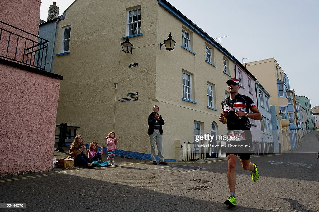 An athlete competes in the run section of Ironman Wales on September 14, 2014 in Pembroke, Wales.