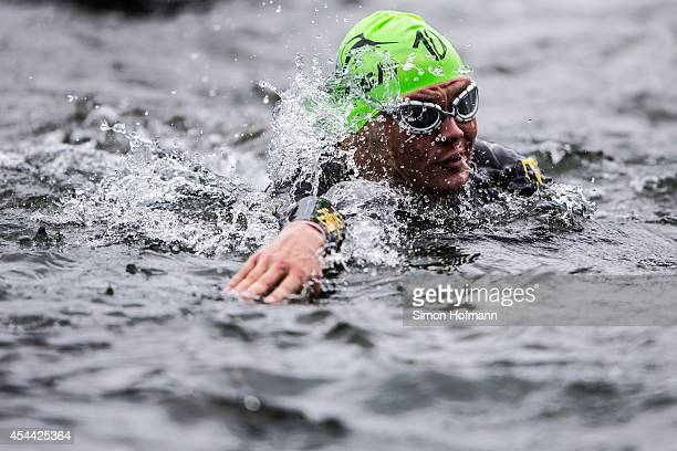 An athlete competes in the swimming at Ironman 703 Zell am SeeKaprun on August 31 2014 in Zell am See Austria