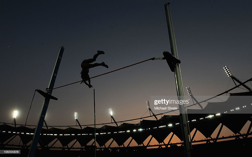 An athlete competes in the women's pole vault final at Jawaharlal Nehru Stadium during day nine of the Delhi 2010 Commonwealth Games on October 12, 2010 in Delhi, India.