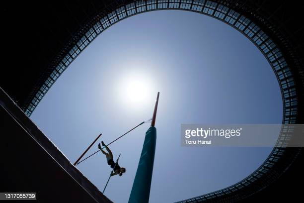 An athlete competes in the women's pole vault final during the Ready Steady Tokyo - Athletics Olympic test event, part of the World Athletics...
