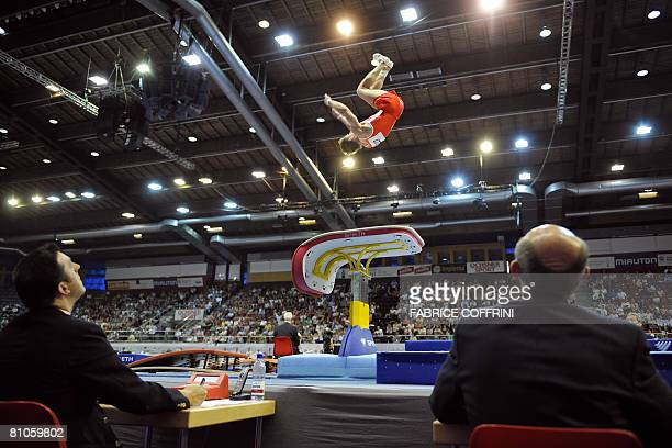 An athlete competes on the vault as judges look at him during the 28th European Men's Artistic Gymnastics Championships on May 10 2008 at Malley...