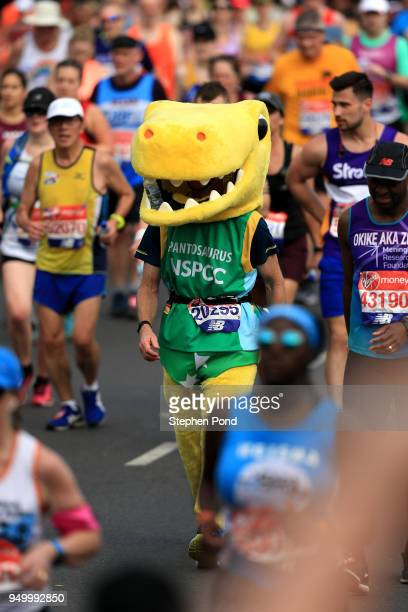 An athlete dressed as a dinosaur runs during the Virgin Money London Marathon on April 22 2018 in London England