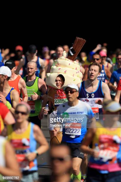 An athlete dressed as an ice cream runs during the Virgin Money London Marathon on April 22 2018 in London England