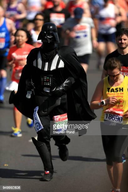 An athlete dressed as Darth Vader runs during the Virgin Money London Marathon on April 22 2018 in London England