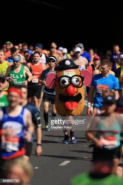 An athlete dressed as Mr Potato Head runs during the Virgin Money London Marathon on April 22 2018 in London England