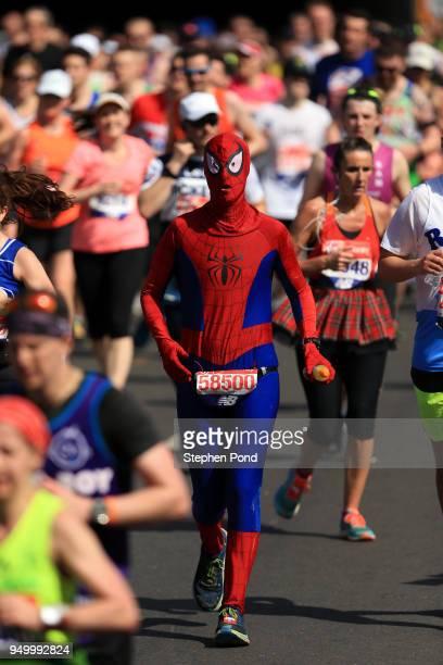 An athlete dressed as Spiderman runs during the Virgin Money London Marathon on April 22 2018 in London England