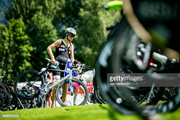 An athlete drops off her bike at the transition area ahead of tomorrow's IRONMAN 703 Zell am SeeKaprun triathlon event on August July 26 2017 in Zell...