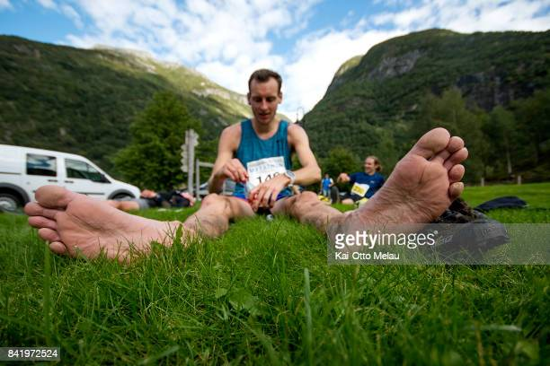 An athlete drying his feet in the air at the finishline at Hardangervidda Marathon on September 2 2017 in Eidfjord Norway Hardangervidda Marathon...