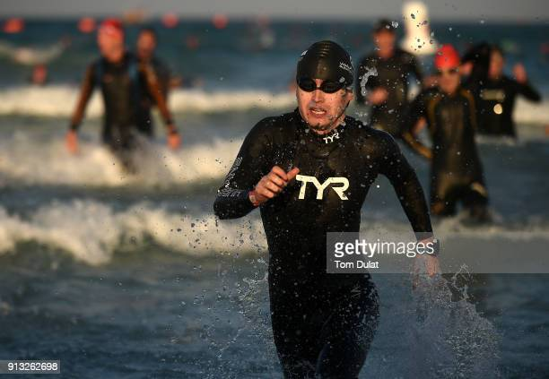 An athlete exits the water during the Ironman 703 Dubai 2018 on February 2 2018 in Dubai United Arab Emirates