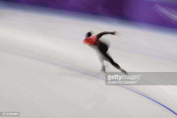 An athlete from Canada takes part in a training session of speed skating at the Gangneung Oval before the Pyeongchang 2018 Winter Olympic Games on...