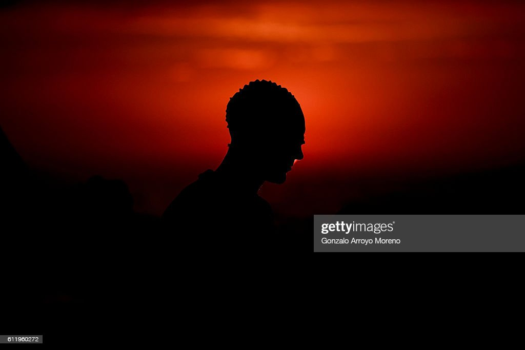 An athlete gets ready at sunrise prior to start the swimming course of the Ironman Barcelona on October 2, 2016 in Calella, Spain.