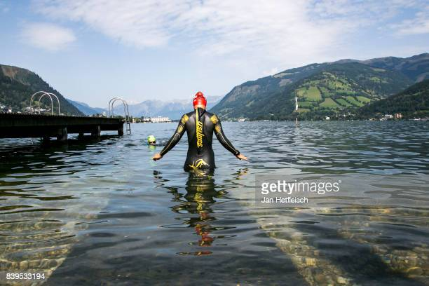 An athlete goes into the Zeller lake for a training session ahead of tomorrow's IRONMAN 703 Zell am SeeKaprun triathlon event on August July 26 2017...
