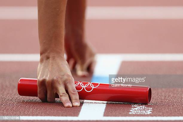 An athlete holds the baton during the Women's 4 x 400m Relay Round 1 heats on Day 14 of the London 2012 Olympic Games at Olympic Stadium on August 10...