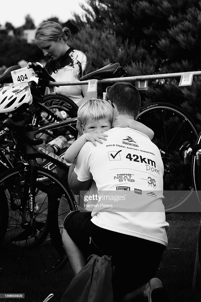An athlete hugs his son as he sets up his bike prior to the Challenge Wanaka on January 18, 2013 in Wanaka, New Zealand.