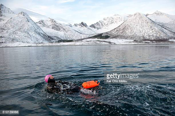An athlete in the water on February 13 2016 in Svolvar Norway Athletes choose to swim in a drysuit due to the cold water in the fjord The water...